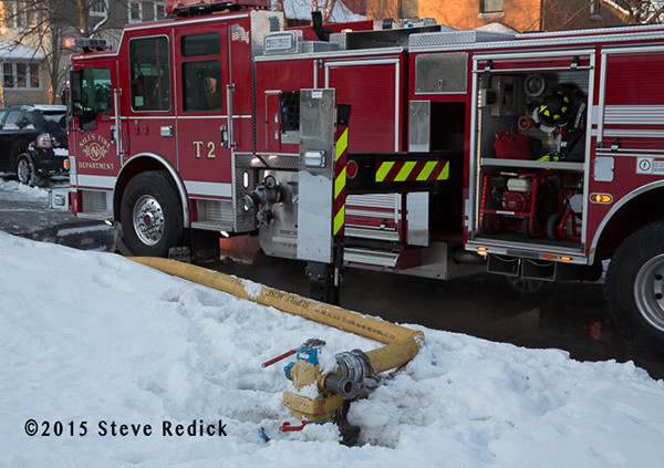 Pierce fire truck at fire scene  with hydrant covered by snow