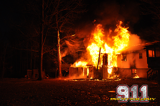 house fyllu engulfed in flames at night