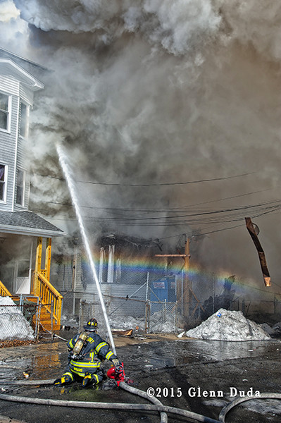fireman working at a fire scene with heavy smoke
