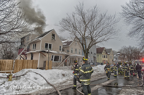 firemen at winter house fire scene