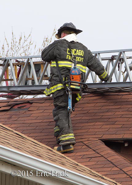 fireman on roof with ladder