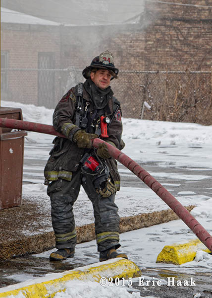 CHicago fireman with charged hose line