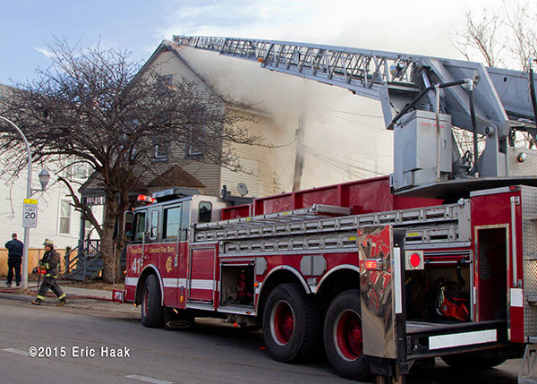 Chicago FD Truck 41 to the roof of a house fire