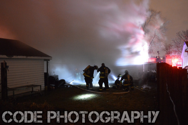 firemen battle house fire at night