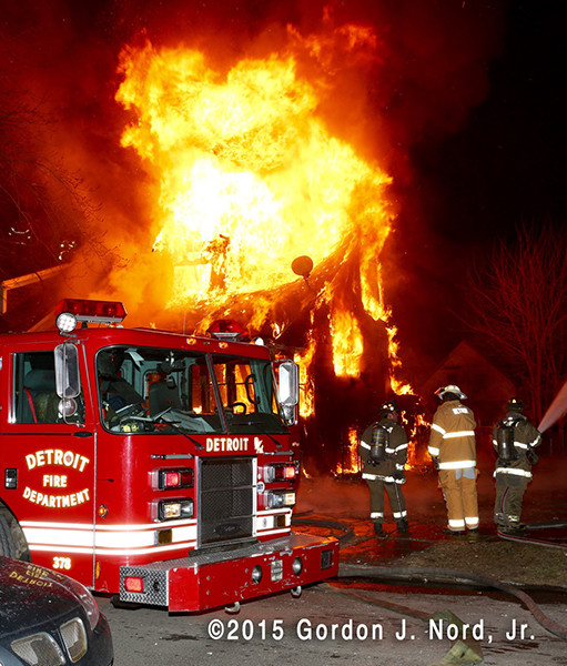Detroit firemen at night house fire