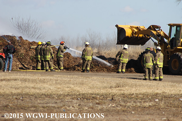 firemen extinguish compost pile fire in Wisconsin