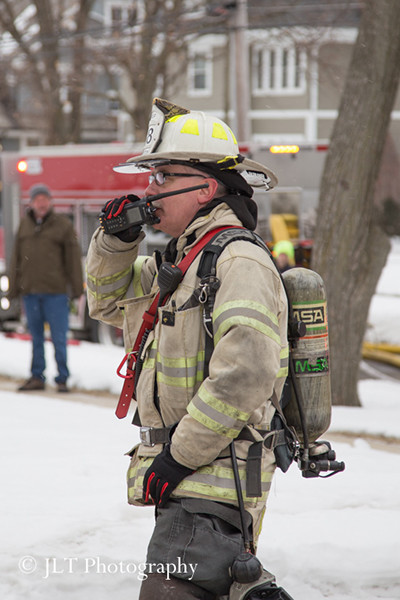 fire chief in PPE with radio at fire scene