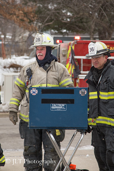 fire chiefs with command board at fire scene