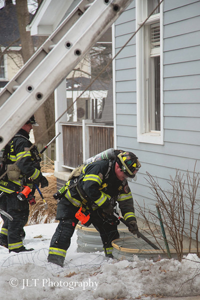fireman break window well cover at house fire