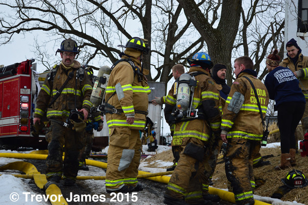 firemen at house fire scene