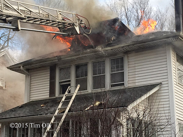 house fire with flames through the roof