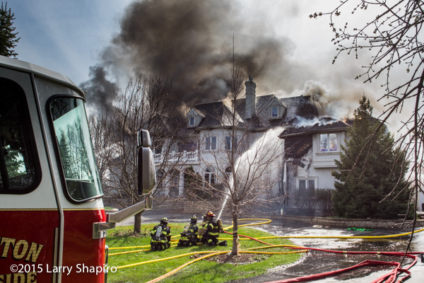 mansion on fire with heavy smoke