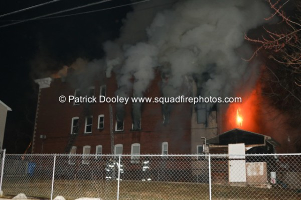 heavy smoke from night fire at apartment building