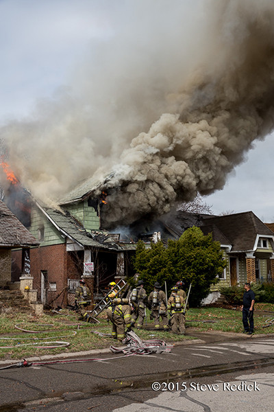 Detroit firemen at the scene of a well involved vacant dwelling fire