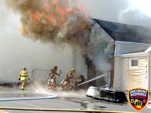 firemen battle heavy fire at a house fire