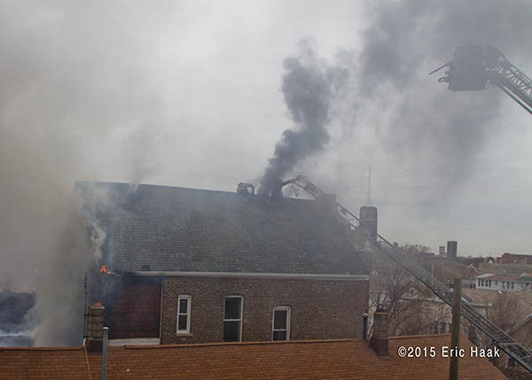 smoke from roof of house on fire