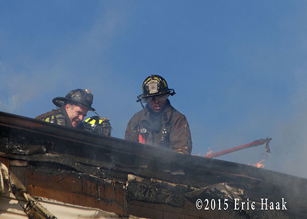 firemen on roof of fire building