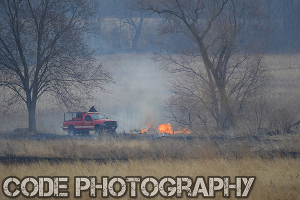 firemen extinguish grass fire