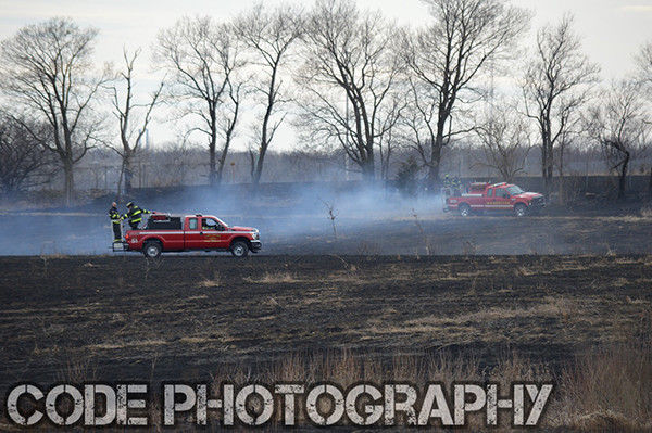 grass fire scorches large field