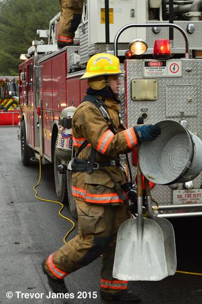 fireman with salvage tools after fire