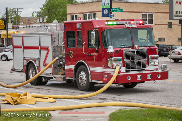 Fire engine with charged hose at scene. ©2015 Larry Shapiro