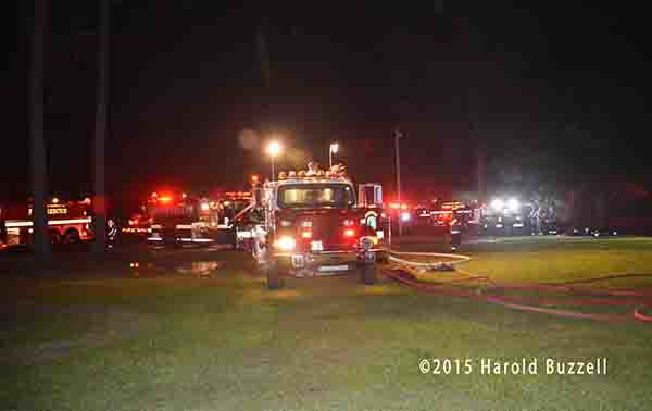 fire engines pumping at night fire scene