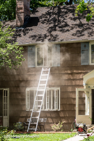 ladder to the window with smoke at a house fire