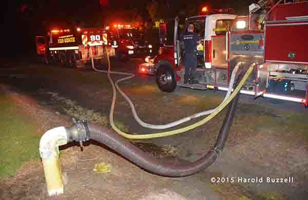 fire engine drafting from a dry hydrant and filling tanker