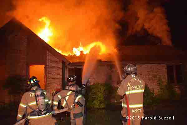 firemen battle rural house engulfed in fire