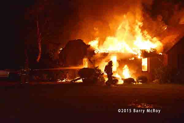 rural house engulfed in fire