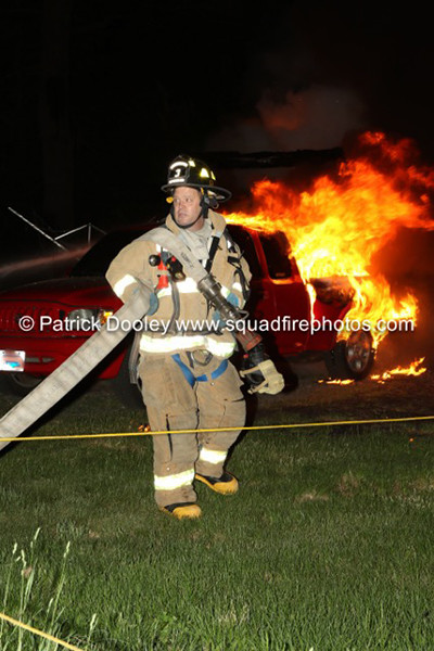 firefighter at night with flames