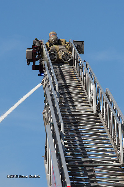 fireman working elevated master stream
