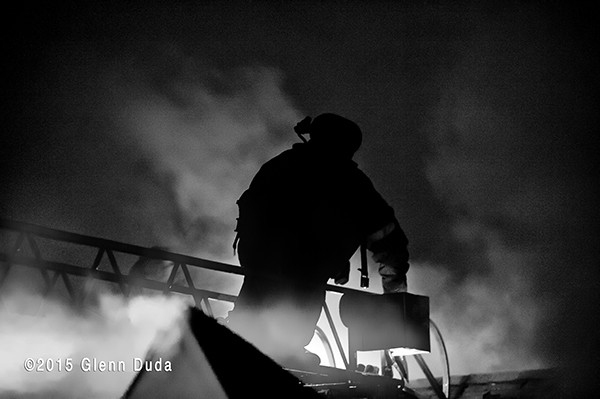 silhouette of fireman at night