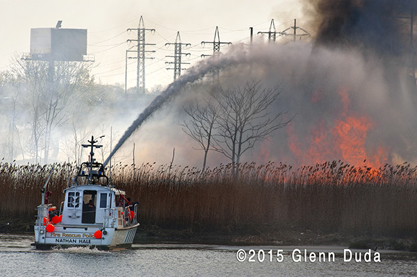 fire boat battles a large brush fire in West Haven CT