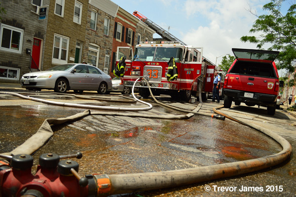 fire engine hooked to hydrant at fire scene
