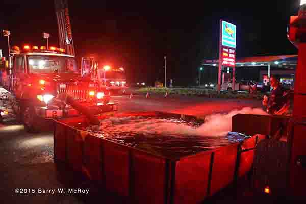 fire engine drafts from dump tank at fire scene