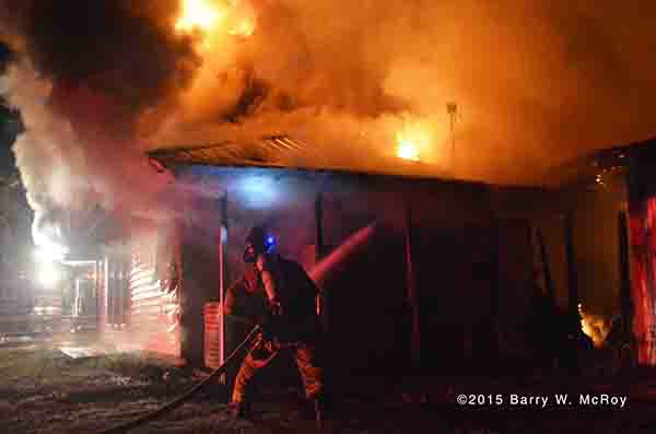 fireman battle restaurant fire at night