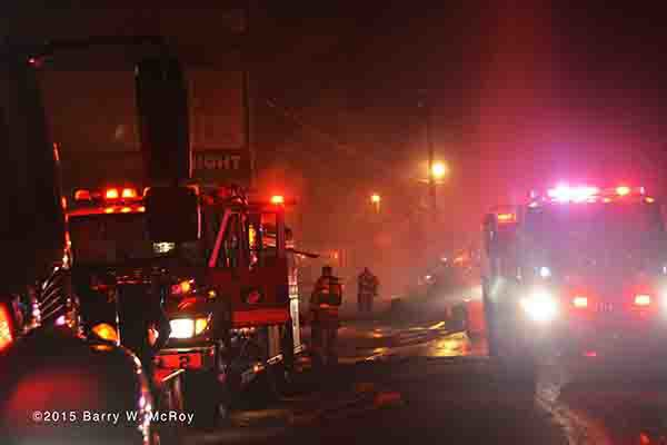 fire trucks engulfed in smoke at night fire scene