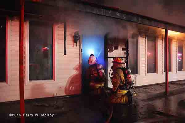 firemen battle a restaurant fire at night