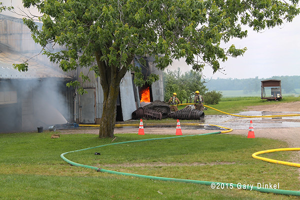 firemen in Canada battle a storage garage fire