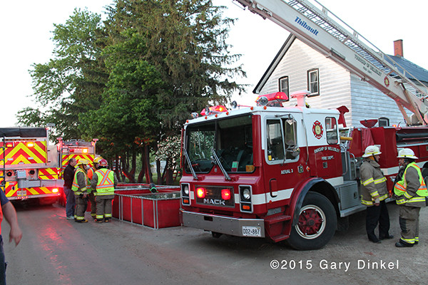 Thibault fire truck in Wellesley Township Canada drafts from a portable tank