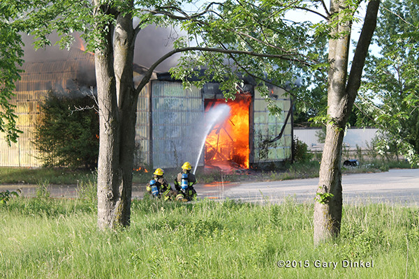 firemen in Canada battle a large garage fire
