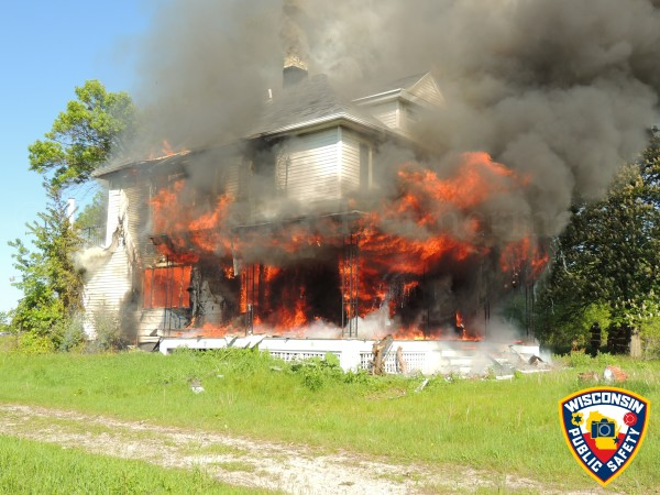 vacant house being burned down