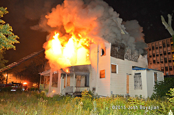 firemen battle house engulfed in fire