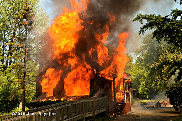 vacant house fully engulfed in fire