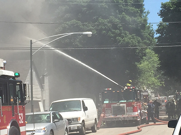 fire truck deploys deck gun at fire scene