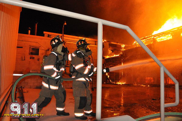 firemen battling a fire at night