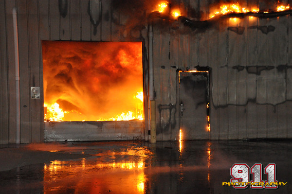 night fire scene at large warehouse