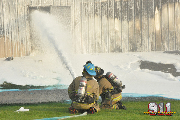 firemen apply foam at chemical fire