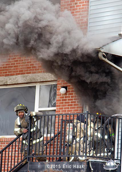 firemen enter house fire engulfed in smoke